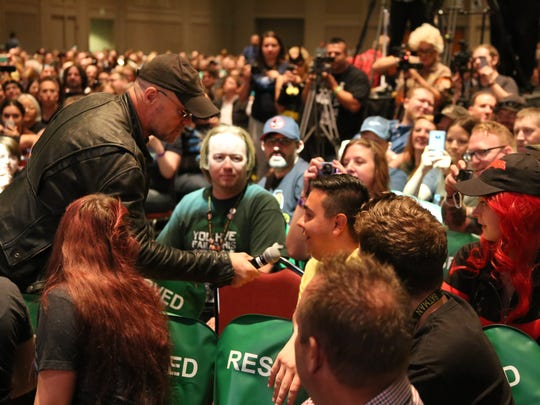 Michael Rooker asks an audience member about his workout regimen. Thousands of Salt Lake Comic Con fans attended the final day of the convention Saturday, Sept. 3, 2016.