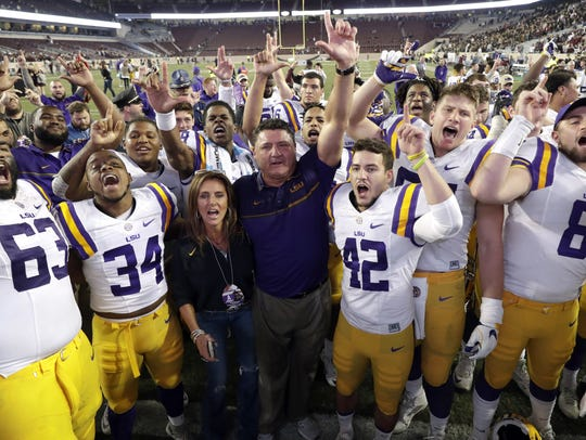 LSU coach Ed Orgeron celebrates with his players after