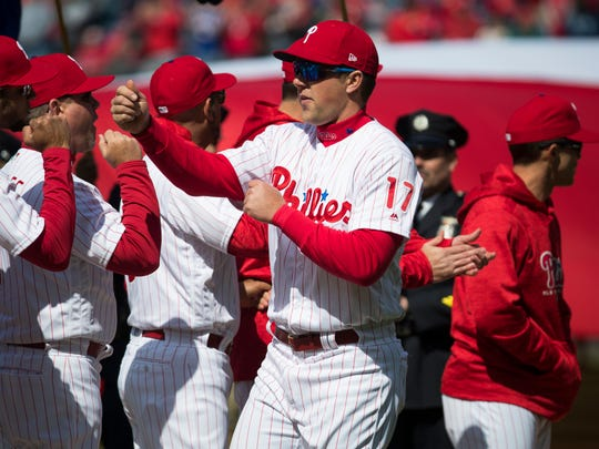 Phillies' Rhys Hoskins (17) fist bumps his teammates during player introductions at the Phillies home opener at Citizens Bank Park.