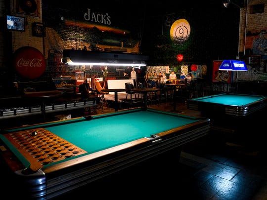 A mural of eight regulars and bartenders can be seen on the back walls past a number of pool tables at Jack's Pool Room in Paris, Tenn., Wednesday, July 25, 2018.