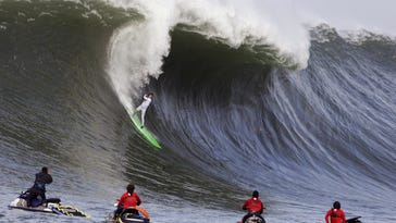 Nic Lamb rides a wave during the third heat of the first round of the Mavericks Invitational big wave surf contest Friday, Jan. 24, 2014, in Half Moon Bay.