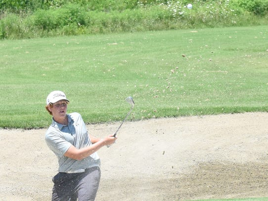 Tucker Teague of Little Rock blasts out of the bunker