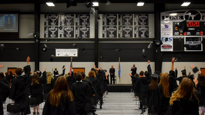 The Lone Grove High School class of 2020 throws caps into the air to mark the end of graduation ceremonies Friday. Even though social distancing guidelines were put in place, the school still held its scheduled graduation ceremony.