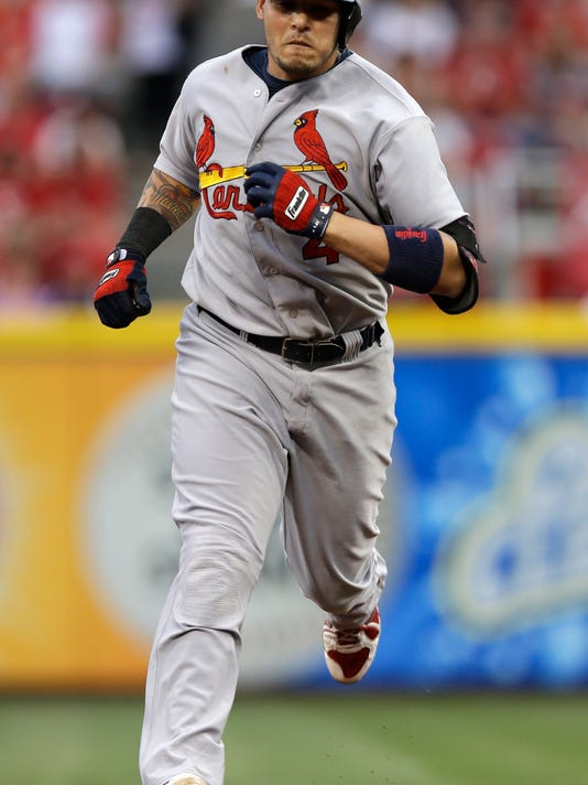 St. Louis Cardinals' Yadier Molina rounds the bases after hitting a solo home run off Cincinnati Reds starting pitcher Tony Cingrani in the fourth inning of a baseball game, Saturday, May 24, 2014, in Cincinnati. (AP Photo/Al Behrman)