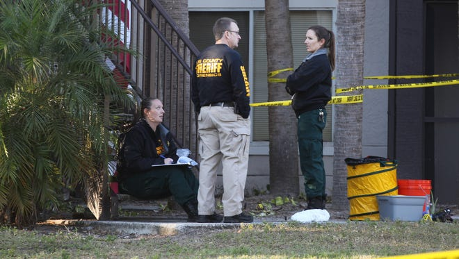 Members of the Lee County Sheriff's Office work the scene of a death investigation at Iona Lakes on Sunday.