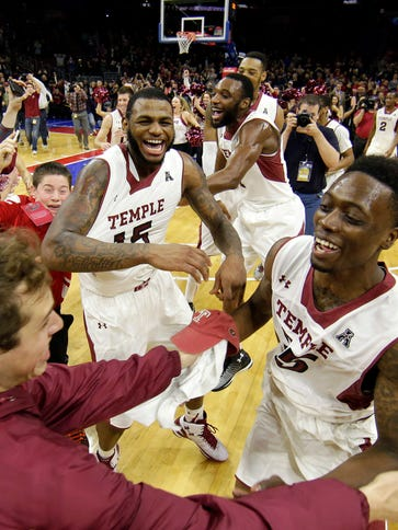 Temple players and fans celebrate after beating Kansas.