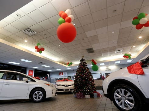 A decorated showroom advertising a year-end Toyotathon in Southfield, Mich.