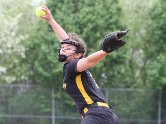 McAuley High School pitcher Gracie Smith throws against