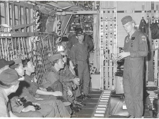 U.S. Air Force Master Sgt. Carl Sellers briefs Vietnamese