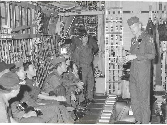 U.S. Air Force Master Sgt. Carl Sellers briefs Vietnamese military passengers on the operation of a C-130A military transport aircraft while on the ground at Tan Son Nhut Air Base in South Vietnam. His tour-of-duty in South Vietnam lasted from November 1972 to January 1973.