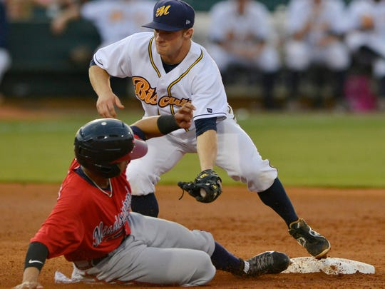 Montgomery Biscuits' Ryan Brett, right, (1) prepares to make the out at second base on Mississippi Braves' Elmer Reyes (14) during their game at Riverwalk Stadium on Wednesday, June 4, 2014.