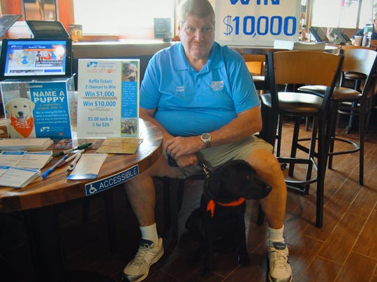 Dave Gaide and their second female black lab puppy Guide Dog, Patton, named after Gen. Patton.