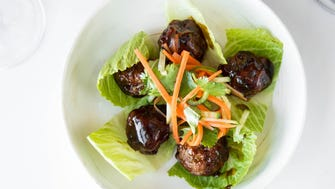 The banh mi duck lettuce wraps from Louie's Wine Dive, which is opening in June in Midtown.