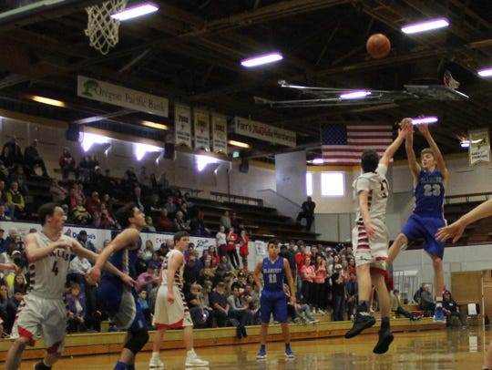 Blanchet's Mike Bashaw launches a jump shot against