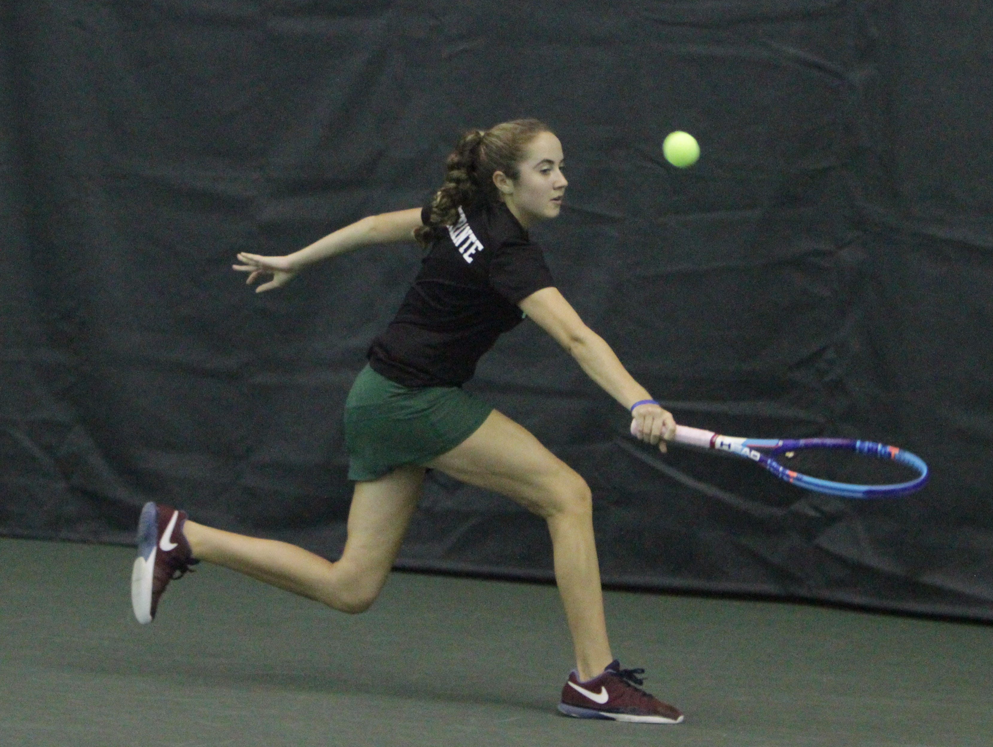 Yorktown's Caitlin Ferante returns the ball on her backhand during the 2016 Section 1 Tennis Tournament finals at Sound Shore Indoor Tennis in Port Chester on Sunday, Oct. 23rd, 2016.