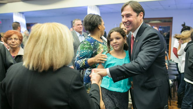 Mark Assini greets supporters after announcing that he will run for Congress in 2016 at the Italian-American Community Center in Gates on Tuesday.