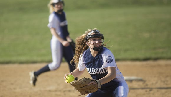 Dallastown's Gabby Jeanmenne throws to first after