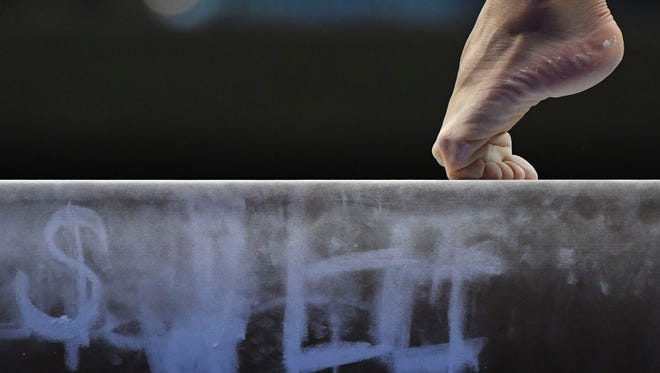 Detail view of a gymnast's foot on the balance beam before the women's gymnastics U.S. Olympic team trials on July 8, 2016, at SAP Center in San Jose, California.