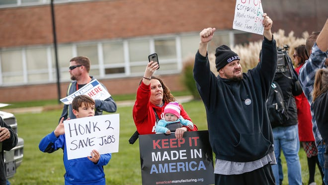 Employees of Rexnord Bearings in Indianapolis, local union reps and family members of the employees protest Nov. 11, 2016, Rexnord's decision to move 300 jobs to Mexico.