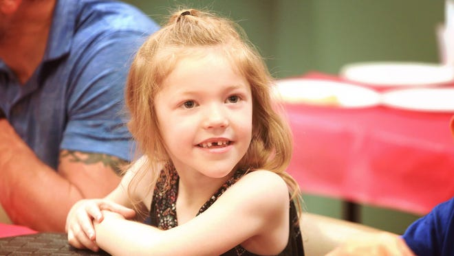 Addyson Benton smiles during her sixth birthday party in West Chester, Ohio, on June 17, 2017. The Bentons moved to Colorado two years ago because they wanted the right to obtain a doctor's prescription for marijuana oils, patches and other products to treat Addyson's severe seizure disorder called myoclonic epilepsy.