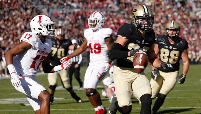 Jackson Anthrop of Purdue rushes for a touchdown at 4:49 in the second quarter against Indiana in the battle for the Old Oaken Bucket Saturday, November 25, 2017, at Ross-Ade Stadium. Purdue defeated rival Indiana 31-24 to reclaim the bucket.
