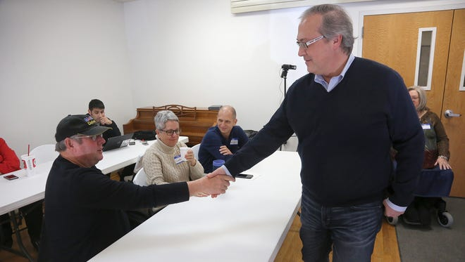 U.S. Rep. David Young greets a constituent. Young conducted a town-hall meeting at the Milo Community Center on Jan. 26.