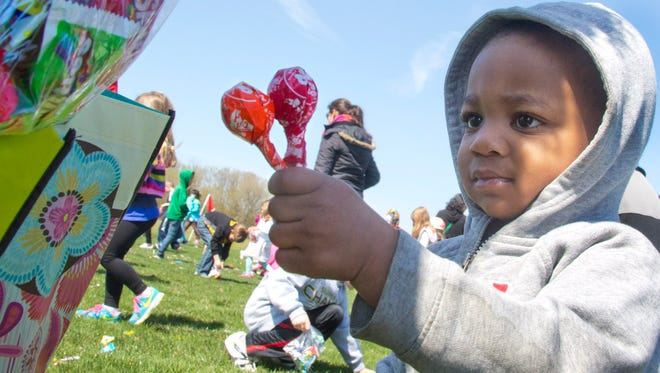 Kamarie Taylor gathered Tootsie Pops after candy was dropped from a helicopter at the Spring Creek Church's Spring Candy Fling in 2016. This year's Spring Candy Fling is Saturday, April 21.