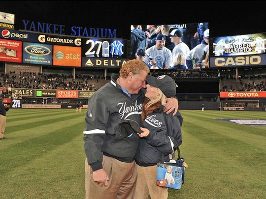 New York Yankees president Randy Levine and his wife Mindy pose together at Yankee Stadium.