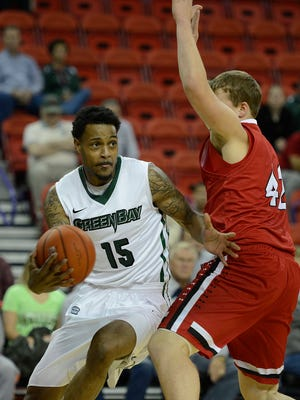 UW-Green Bay's Greg Mays tries to get around Ripon's Justin Leistikow in the first half during Thursday night's game at the Resch Center in Ashwaubenon.