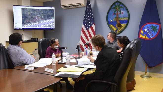 Members of the Chamorro Land Trust Commission view a map on a video monitor, pertaining to a case before the commission, during a meeting in Tamuning on Thursday, June 21, 2018. The commission did not decide what to do about controversial Land Trust leases issued to people who switched places in line. It is expected to take up the issue during its August meeting. See story, Page 4