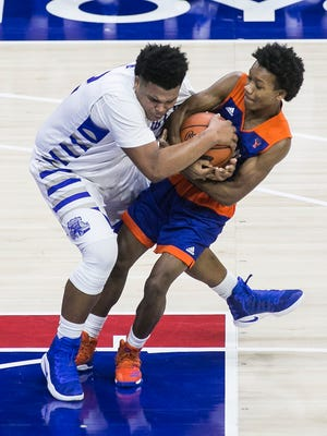 York High's Nasir Smallwood (4) and Steel High's Tim Kater (42) get tied up while going for the loose ball during the second quarter of a non-conference basketball game on Wednesday, Jan. 11, 2017, at the Wells Fargo Center, in Philadelphia. Steel High won 58-51. Amanda J. Cain photo