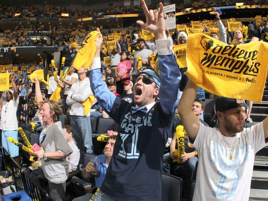 May 11, 2015 -   Memphis Grizzlies fans Leigh Ann Griffin, Lucas Horrell, and Justin Hill cheer on their team against the Golden State Warriors during Game 4 at FedExForum.