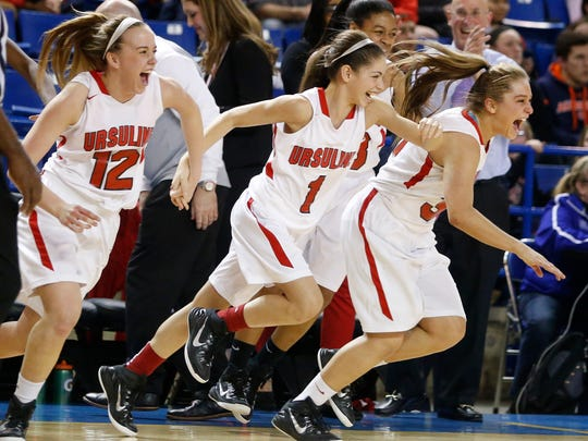 Ursuline's (from left) Kailyn Kampert, Alisha Lewis and Adrianna Hahn rush to join their teammates on the court as time expires in Ursuline's 53-41 win in the DIAA championship game.
