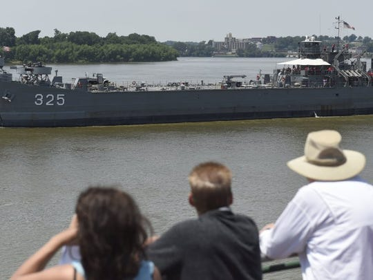 JASON CLARK / COURIER & PRESS Spectators enjoy the view of the LST 325 during the ShrinersFest World War II invasion re-enactment along the Evansville Riverfront on Saturday.