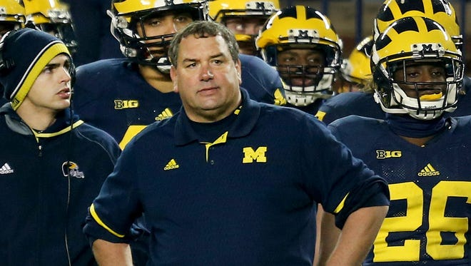 Michigan head coach Brady Hoke on the sidelines during second half action against Maryland on Saturday, November 22, 2014 Michigan Stadium in Ann Arbor.