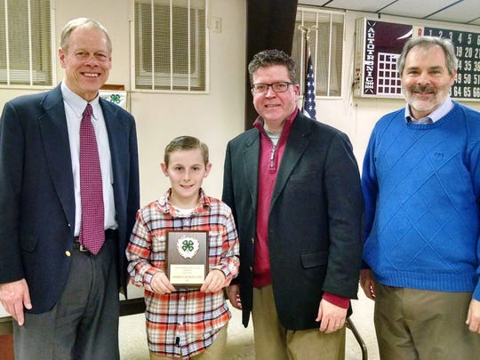 Andrew Burkholder, Chambersburg, was awarded the 2016 Outstanding First Year Member plaque. Pictured (left to right): Bob Ziobrowski, Franklin County Commissioner, Andrew Burkholder, Chambersburg, Franklin County Commission Dave Keller and Michael Martin, 4-H Extension Educator.