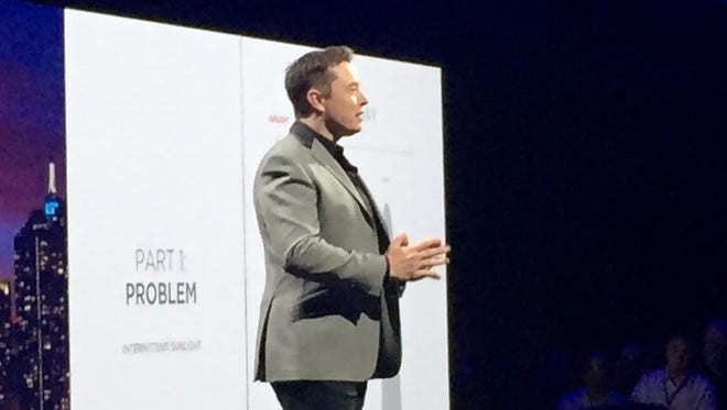 Elon Musk introduces a new home battery at a Tesla event in Hawthorne, Calif.