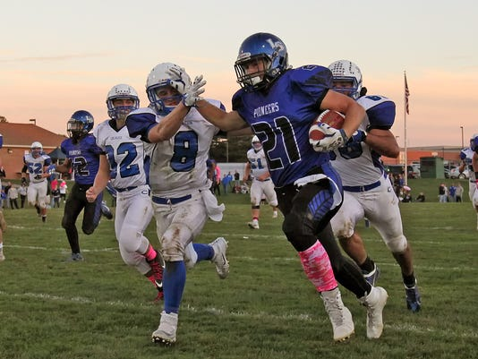 Lampeter-Strasburg's Shane Lawler (21) fights off a tackle by Cocalico's Trevor Fichthorn (8) during first half action at Lampeter-Strasburg High School Monday October 5, 2015. Chris Knight - GametimePa.com