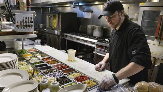 Louis Brott, executive chef at Anton's, cleans up and