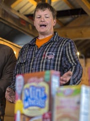 Sugarmaker Roger Brown of Richmond speaks during a news conference at Slopeside Syrup in Richmond on Tuesday.