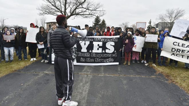 Stephon Chapman speaks to students during a rally Friday at Racine Horlick High School where students talked about the alleged taunting at a basketball game.