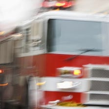 The front of a firetruck in motion