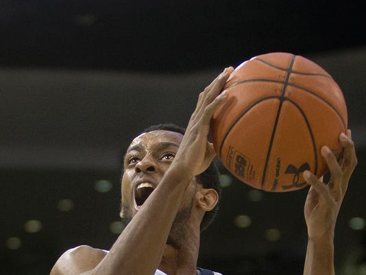 Old Dominion's Trey Freeman drives to the basket during the first half of an NCAA college basketball game against Rice, Saturday, Feb. 13, 2016, in Norfolk, Va. (L. Todd Spencer/The Virginian-Pilot via AP)  MAGS OUT; MANDATORY CREDIT