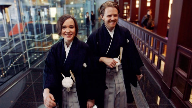 Ellen Page, left, and Ian Daniel travel the world in 'Gaycation,' one of the first series on the new cable channel, Viceland.