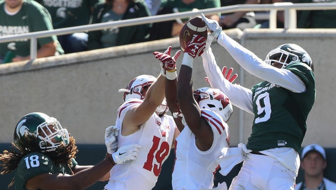 Michigan State WR Donnie Couley is defended by the Wisconsin defense in the second half Sept. 24, 2016 at Spartan Stadium in East Lansing.