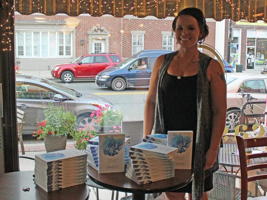 Author Krystle J. Bailey stands inside Casciano Coffee