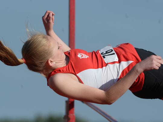 Richmond's Riley Austin competes in the high jump during the track and field sectional Tuesday, May 19, 2015, in Connersville.
