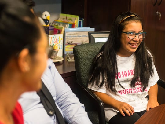 Leuchter School fourth grader Alexica Perez chats with