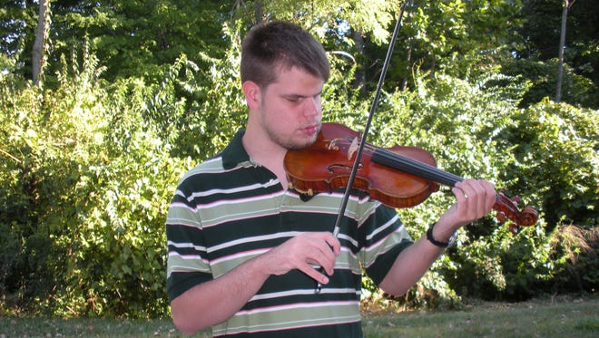 Kyle Conley plays the violin at Wright State University.