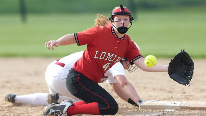 Lomira High School softball's Hannah Verhunce reaches for an overthrown ball while attempting to tag out a Mayville player Friday, May 18, 2018 during their game in Lomira. Doug Raflik/USA TODAY NETWORK-Wisconsin